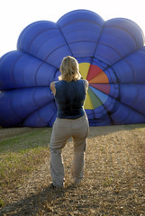 balloonist inflating her balloon