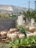 a santorini yard in greece full of clay pottery poster
