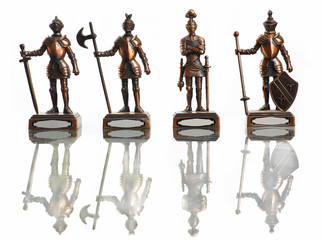 four figures of knights isolated on white