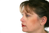 Profile of middle aged woman looking forward. poster