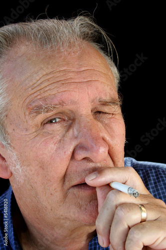 Senior male smoking a cigarette.