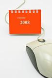 Year 2008 mini desktop calendar and computer mouse poster