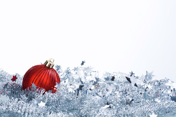 Horizontal image: christmas red ball and silver tinsel