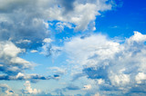 White fluffy clouds in the blue sky. poster