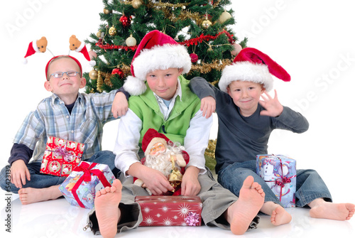 happy youngsters, three  boys in front of Xmas, Christmas