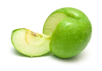 Ripe apple of green color with the segment cut out from it