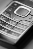 Monochromatic image of the keypad of a cell phone. poster