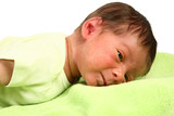 Adorable newborn baby on green blanket. poster