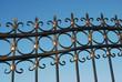 Metal fence over blue sky