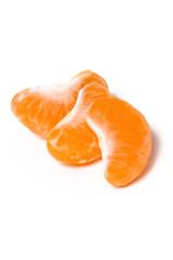 Three tangerine segments on white background