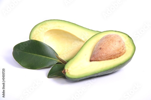Avocado pear halves on white background