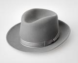 Old vintage felt hat on light grey surface poster