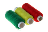 Coils with threads of three colors: red, yellow, green. poster