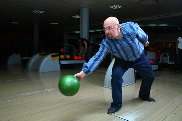 The man, a playing bowling alley
