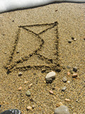 The envelope with the letter is drawn on wet sea sand poster