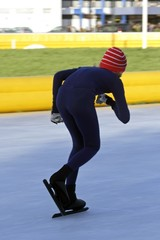 Speed ice skater in winter in the Netherlands