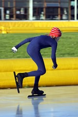 Young man speed ice skating in the Netherlands