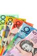 Australian money, fanned on a white background.