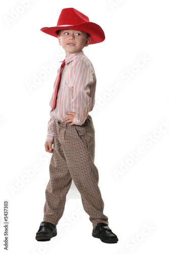 The boy in a cowboy's hat and a red tie