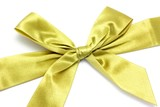 Golden ribbon with bow isolated on white