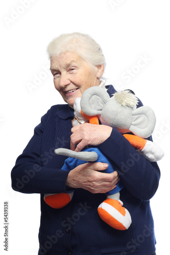 Senior woman with stuffed animal toy