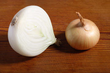 Onion and a half on old wooden board