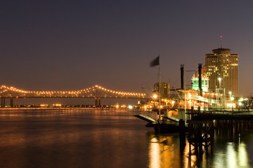 Hotels and bridge over Mississippi river at dusk, New Orleans