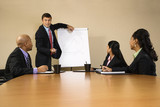 Businesspeople at conference table watching presentation. poster