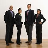 Portrait of businessmen and businesswomen standing smiling. poster