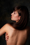 Sexy brunete girl with naked back poster