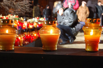 lighting candles on the square