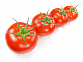 Isolated fresh tomatoes with stems close-up (vivid colors)
