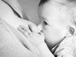 A toddler baby breastfeeding