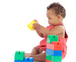 Adorable baby girl playing with building blocks