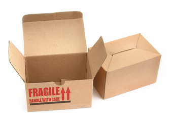 two cardboard boxes againt white background,