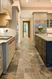 upulent kitchen with slate floors and granite counters poster