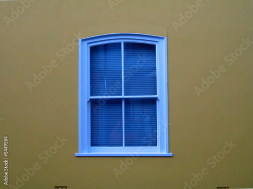 blue window, ochre wall