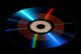DVD / CD-ROM Disk Isolated on Black, With Radiating Rays poster