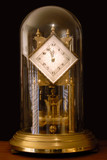 Glass Domed Mantle Clock With Escapement In Blurred Motion poster