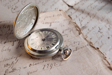 old watch,old-time documents,past and future
