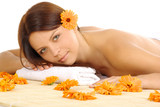 Woman in spa . orange flowers