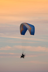 A telephoto of paragliding (with motor)