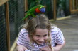 bird pecking on little girls head