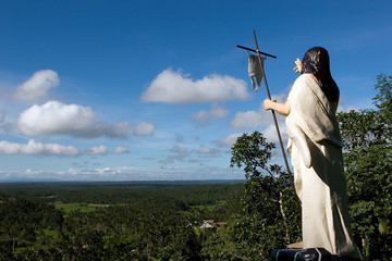 Religious statue on top of a hill