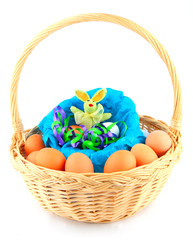 easter bunny in a basket with multicolored chicken's eggs