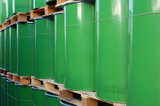 Assembly of green oil drums on palettes poster