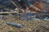 flashlight at a campfire poster