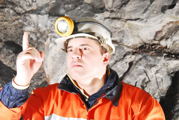 Angry chief miner in mine shaft criticizing stock photo