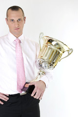 businessman winner with a trophy on white background