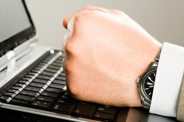 Human  fist on the keyboard of laptop